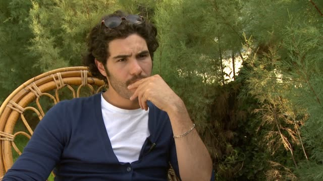 vídeos de stock e filmes b-roll de tahar rahim on the biggest challenge of doing the film at the love and bruises interviews: venice film festival 2011 at venice . - maior