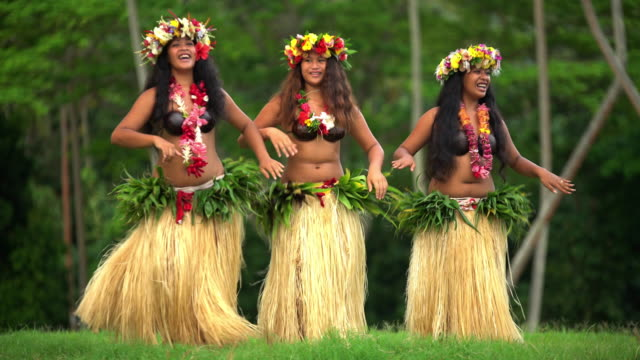 tahitian females in hula skirts and flower headdress - headdress stock videos & royalty-free footage