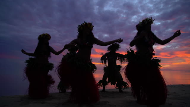 tahitian hula dancers performing barefoot on sunset beach - traditional ceremony stock videos & royalty-free footage