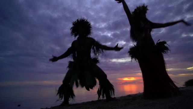 tahitian hula dancers performing barefoot on sunset beach - tahitian culture stock videos & royalty-free footage