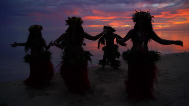 tahitian males in warrior dress on sunset beach - polynesian culture stock videos & royalty-free footage