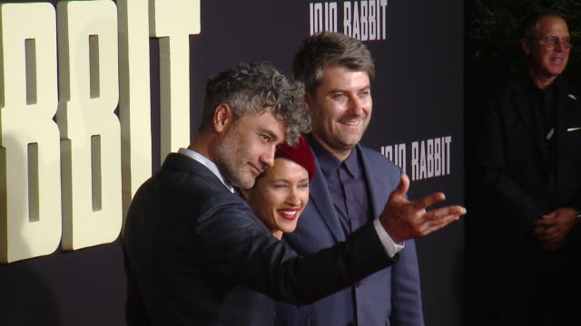 """taika waititi chelsea winstanley carthew neal at the """"jojo rabbit"""" los angeles premiere presented by fox searchlight pictures in los angeles ca - fox searchlight pictures stock videos & royalty-free footage"""