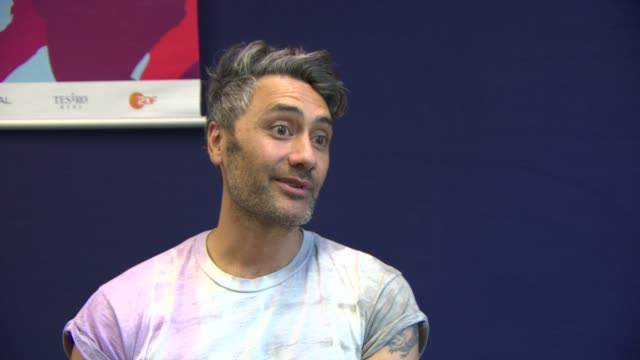 INTERVIEW Taika Waititi on the concept of the film the filming process the fear of someone else doing the idea at 'What We Do in the Shadows'...