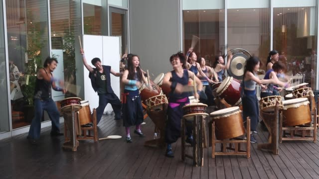 Taiko team 'GOCOO' giving a show in Ginza 4 Chome at the Tsuya Matsuri Gocoo or GOCOO are originally seven female and four male Taiko drummers from...
