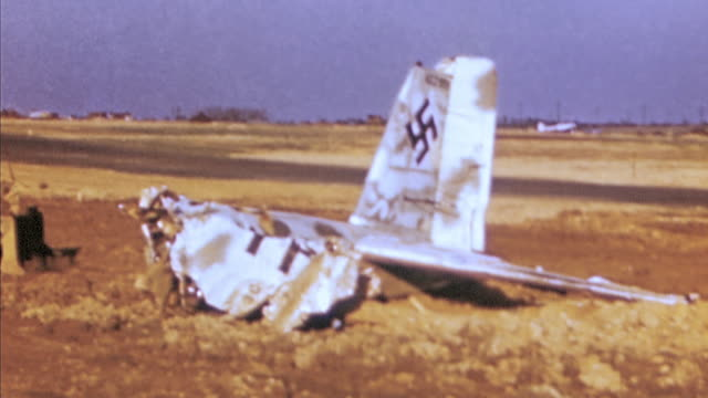 ha tail assembly of wrecked luftwaffe airplane with swastika / germany - airplane tail stock videos and b-roll footage