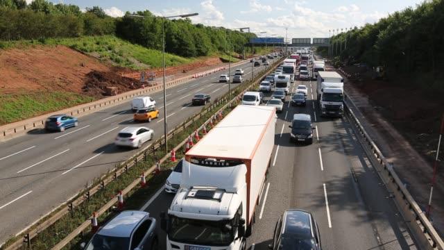 tailbacks on the m1 motorway in the east midlands caused by roadworks, uk. - motorway stock videos & royalty-free footage