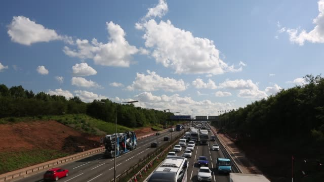 tailbacks on the m1 motorway in the east midlands caused by roadworks with a plane coming in to land at east midlands airport, uk. - noise stock videos & royalty-free footage