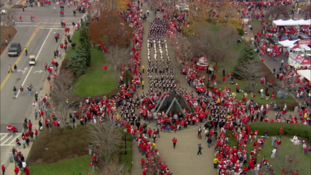 pan tailgate party tents w/ cars parked fg people football fans walking bg near tents - ohio state university stock videos & royalty-free footage