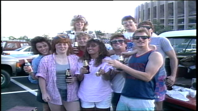 tailgate party while in the parking lot before a genesis concert at veterans stadium in philadelphia pa - phil collins stock videos & royalty-free footage