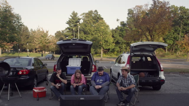 WS Tailgaters watching hdtv in parking lot / Valhalla, New York, United States