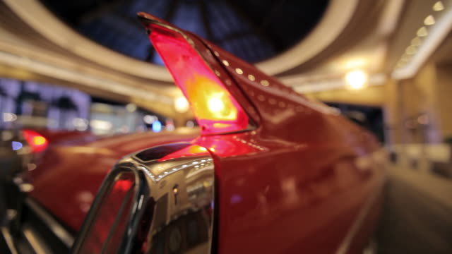 taillights on the tail fins of vintage red convertible shine in the lobby of the palazzo hotel in las vegas, nevada. - the palazzo las vegas stock videos & royalty-free footage