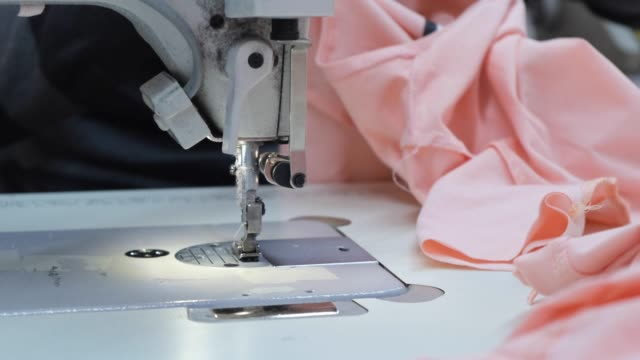 tailor at work on sewing machine - manufacturing machinery stock videos & royalty-free footage
