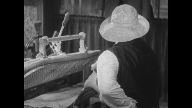 vídeos de stock, filmes e b-roll de 1934 tailor conspires with pig and pours waffle batter into steam press - waffle iron