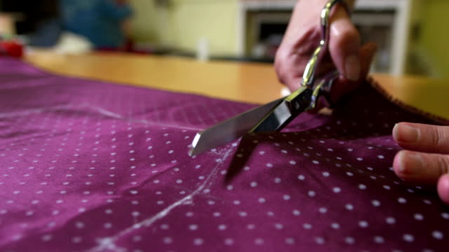 hd: tailor cutting a piece of textile - fashion designer stock videos and b-roll footage