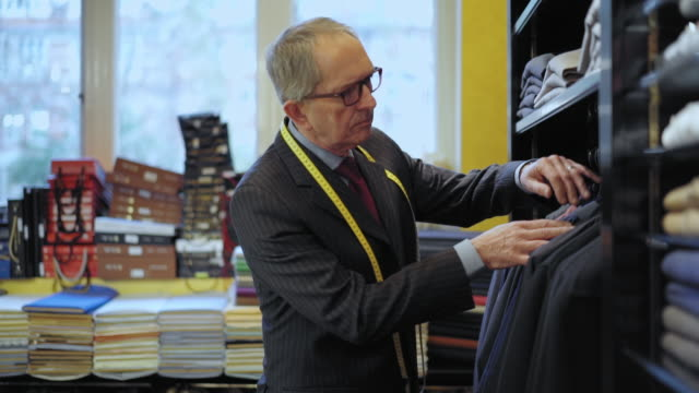 tailor examining shirt and blazer - tape measure stock videos & royalty-free footage