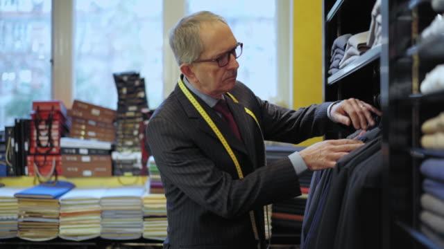 tailor examining shirt and blazer - tape measure stock videos & royalty-free footage