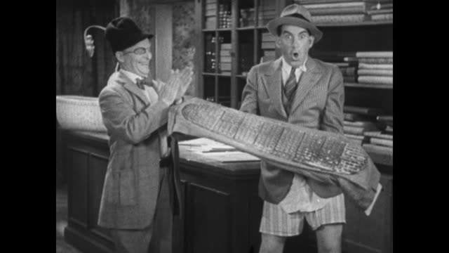 vídeos de stock, filmes e b-roll de 1934 tailor gives irritable customer back his waffle baked pants - waffle iron