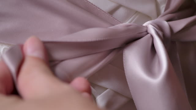 tailor trying a wedding dress with a mannequin, close-up hand is working. - sposa video stock e b–roll