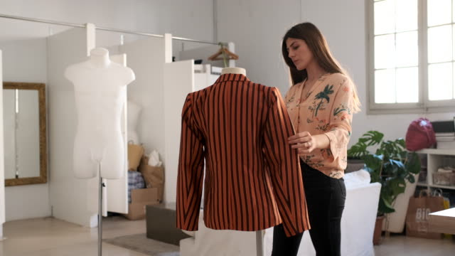 tailor woman working in a small business office, design and fashion industry. - fashion designer stock videos & royalty-free footage