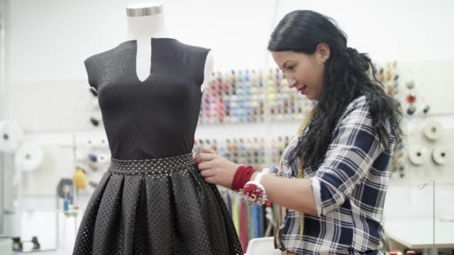 Tailor woman working with mannequin