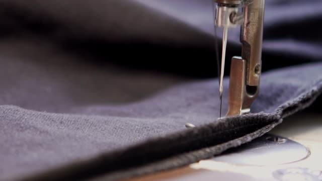slow-mo: tailor working with sewing machine - sewing stock videos & royalty-free footage