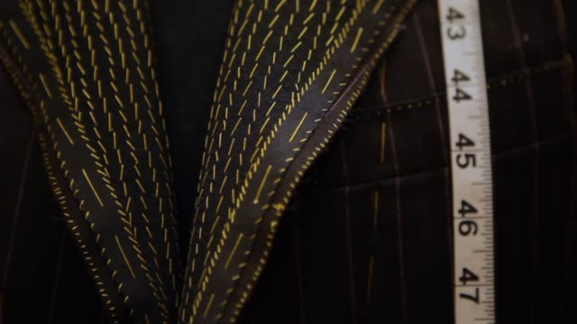 tailored men's suits on a rack - customised stock videos & royalty-free footage