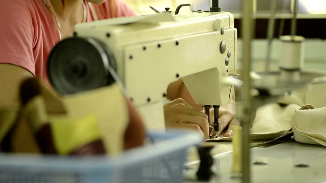tailoring process - woman sewing in industry - needle plant part stock videos and b-roll footage