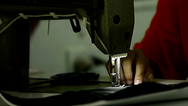 tailoring process - woman sewing in industry - needle plant part stock videos & royalty-free footage