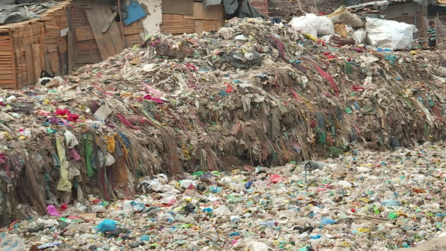 taimur nagar slum in the capital city of new delhi in india is choked with nonbiodegradable plastic everywhere you look there's a sea of plastic from... - delhi stock videos & royalty-free footage