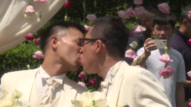 taipei city hall hosts an outdoor wedding party for twenty same sex couples who officially tied their knot on the day that taiwan's new gay marriage... - taiwan video stock e b–roll
