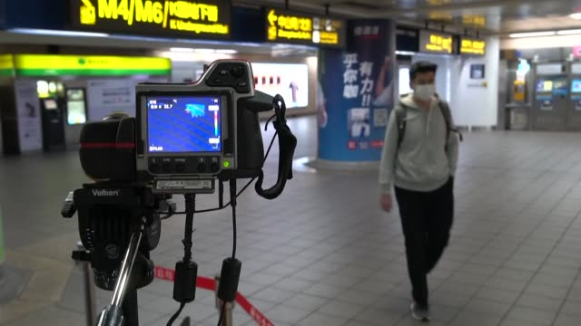 taipei metro begins screening commuters for fever symptoms at a pilot location inside the downtown train station - taiwan stock videos & royalty-free footage