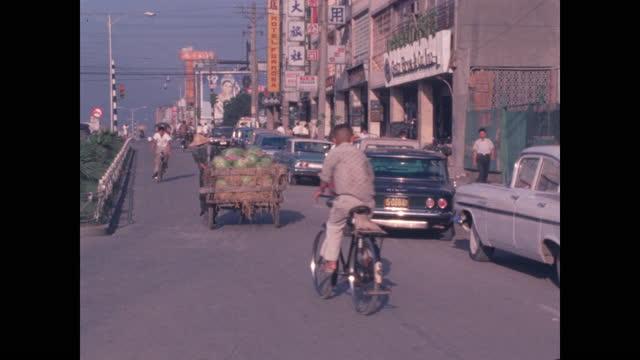 taipei street scenes of cars, bicycles, rickshaws and people - taipei stock videos & royalty-free footage