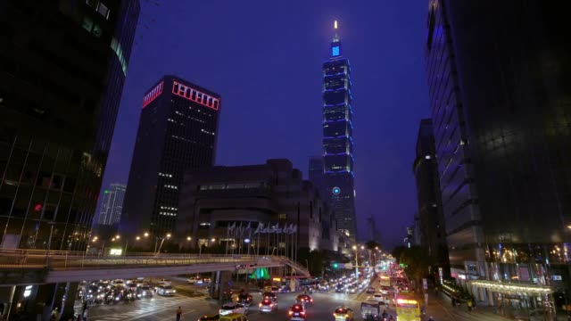 taipei world trade center and taipei 101 in xinyi business district - taipei 101 stock videos and b-roll footage