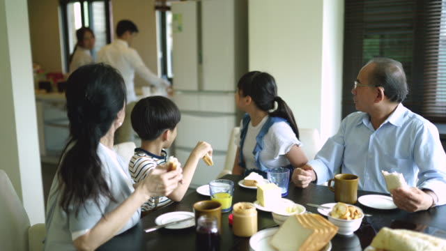 taiwanese big family having breakfast at home - big family stock videos & royalty-free footage