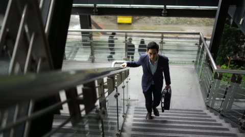 taiwanese businessman moving up stairs - moving up stock videos & royalty-free footage