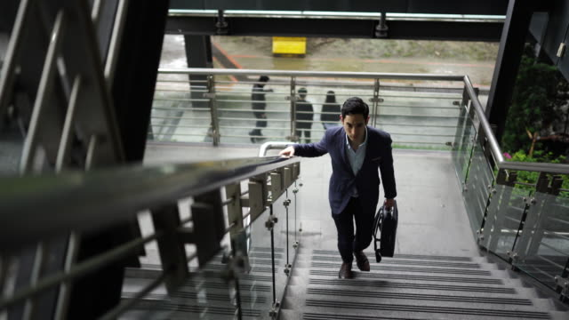 taiwanese businessman moving up stairs - staircase stock videos & royalty-free footage