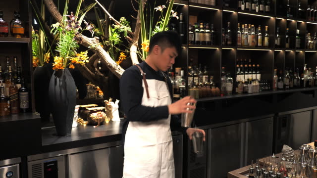 taiwanese cocktail master shaking cocktail for guests. - shaking stock videos & royalty-free footage