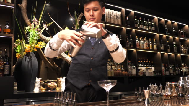 taiwanese cocktail master shaking cocktail for the party. - bar area stock videos & royalty-free footage