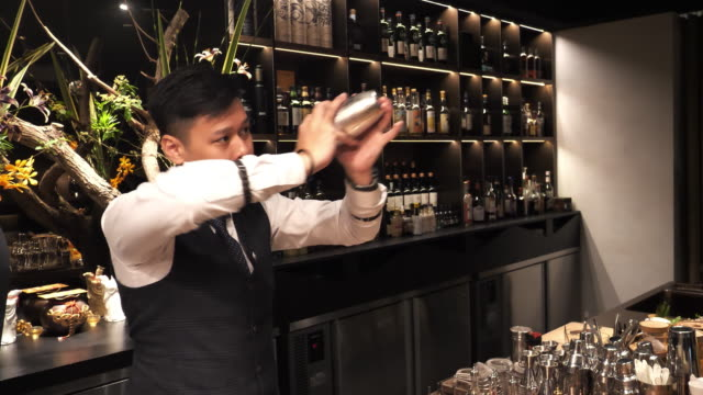 taiwanese cocktail master shaking cocktail. - dressing up stock videos & royalty-free footage