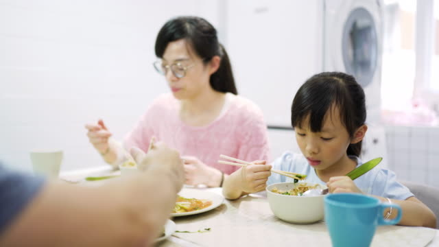 taiwanese family having lunch at home - chinese food stock videos & royalty-free footage
