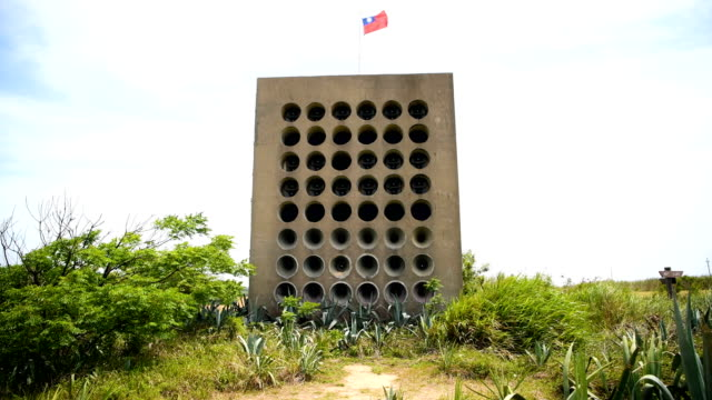 a taiwanese flag flies from a wall of speakers that was used for antichina propaganda at beishan broadcast station on the taiwanese island of kinmen... - taiwanese flag stock videos & royalty-free footage
