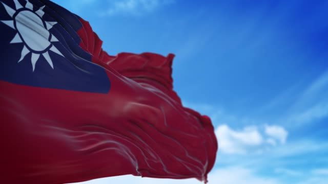 taiwanese flag is waving slowly against blue sky in 4k resolution - taiwanese flag stock videos & royalty-free footage