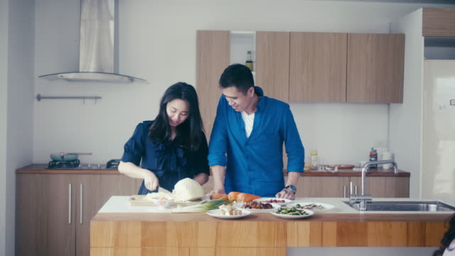 taiwanese husband and wife preparing dinner - mid adult couple stock videos & royalty-free footage