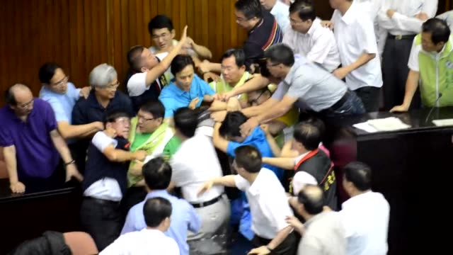 Taiwanese lawmakers brawl on the floor of the islands parliament during a debate on the fate of a controversial nuclear plant CLEAN Taiwan lawmakers...