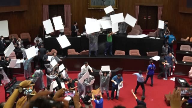 taiwanese lawmakers throw punches and water balloons inside the legislature the third parliamentary brawl in the past two weeks over the nomination... - taiwan stock videos & royalty-free footage