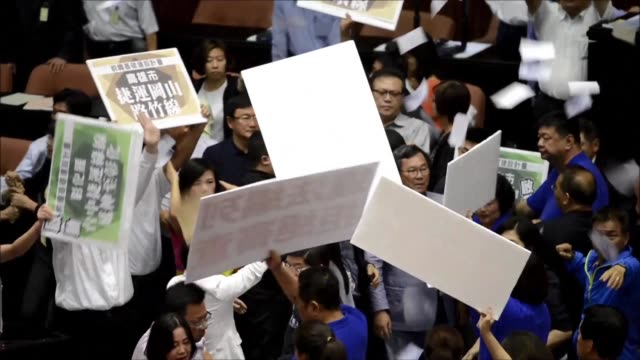 taiwanese lawmakers try to choke each other and throw water bombs during a chaotic session at the island's parliament as the government of president... - taiwan stock videos & royalty-free footage
