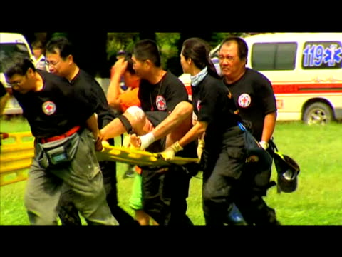 taiwanese military carry rescued victim of typhoon morakot on stretcher 12 august 2009 - taiwan stock videos & royalty-free footage