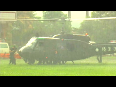 taiwanese military gather at entrance of helicopter to tend to rescued victims of typhoon morakot taiwan 12 august 2009 - taiwan stock videos & royalty-free footage