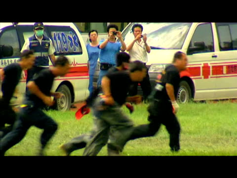 taiwanese military tend to victims of typhoon morakot 12 august 2009 - taiwan stock videos & royalty-free footage