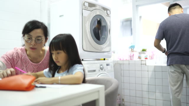 taiwanese mother assisting her daughter in coloring - food coloring stock videos and b-roll footage
